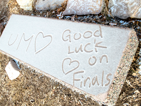 """image of bench with """"good luck on finals"""" written in snow"""