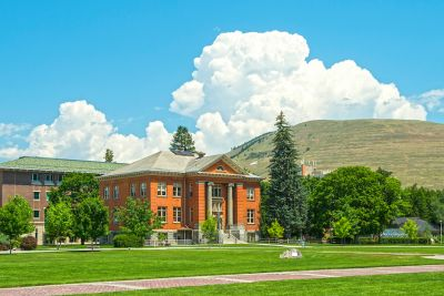 Jeannette Rankin Hall in summer with Mount Jumbo in the backgroud