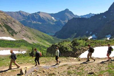 Students walk in Glacier National Park.