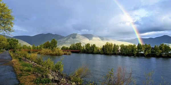 image of rainbow over mount sentinel