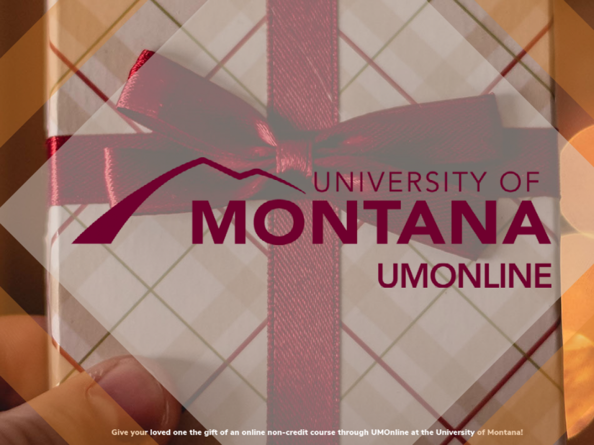 Holiday themed gift box with UM Online Logo in the center.