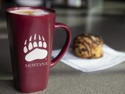 UM branded coffee cup and chocolate covered scone