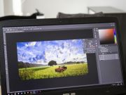 A laptop dispalying the Adobe Creative Cloud Photoshop application