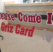 "Front door of Griz Card Center saying ""Please Come In"""
