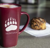 griz coffee cup and pastry
