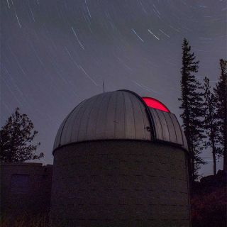blue montian observatory with stary sky in background