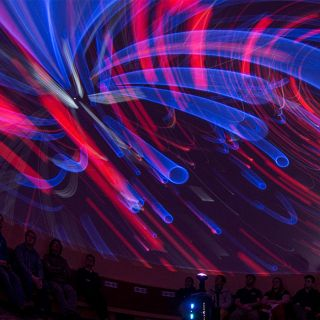 planetarium ceiling displaying whirling light show