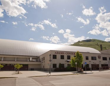 Wide angle shot of the Adams Center at the University of Montana