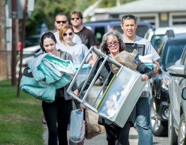 Parents and family members helping their student move in