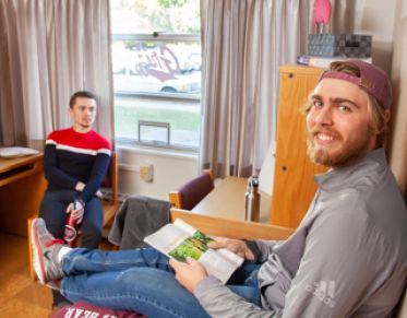 two students in a dorm room