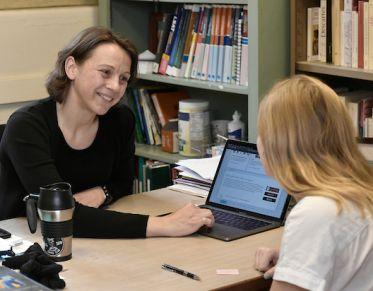 Professor helping a student