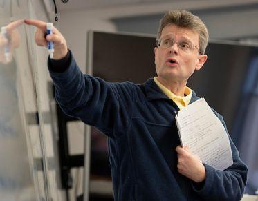 Professor teaching prior to COVID-19.