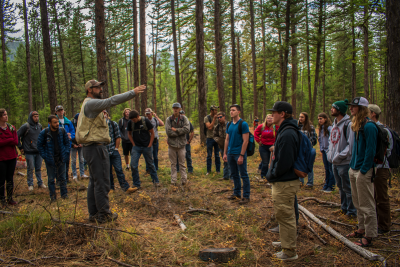 UM Associate Professor Andrew Larson leads forestry students in an outdoor lab