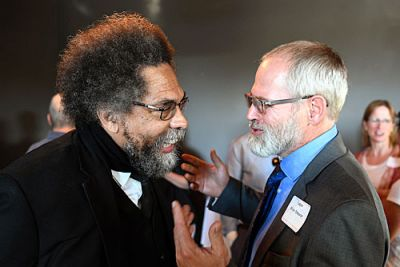 Tobin Shearer, director of UM's African-American Studies program (right), meets with famed scholar and activist Cornel West