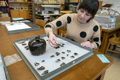 UM graduate student Kate Kolwicz works with fragments of Chinese utilitarian brownware