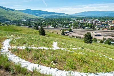 A large peace sign on the ground overlooks Missoula from the North Hills