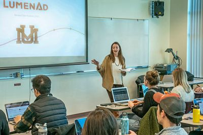 Instructor Jenni Graff teaches a class in the UM business college