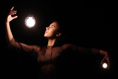 An artistic picture of a dancer with light bulbs