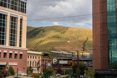 Mount Jumbo as seen through high rise buildings in downtown Missoula