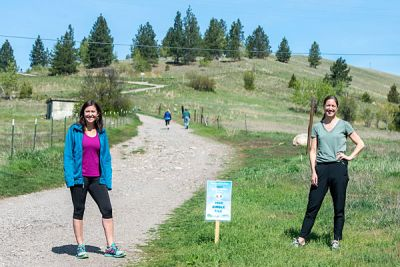 UM researchers Jennifer Thomsen and Libby Metcalf (right) stand at the Missoula trailhead