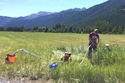 A student works with research gear outside Glacier National Park.