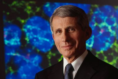 A picture of Anthony Fauci with arms crossed