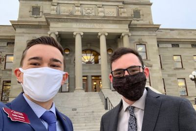 Photo of two journalism studenst who cover Legislature