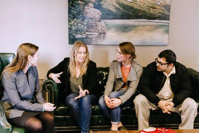 Photo of students meeting with faculty member.