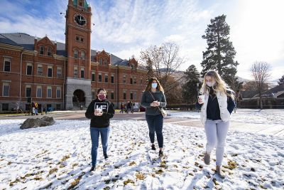 Photo of students walking across campus