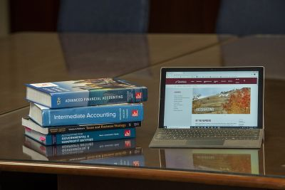 Photo of accounting books and laptop