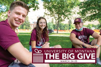 Students smile on the grass at UM for an ad that says The Big Give, March 24-25.