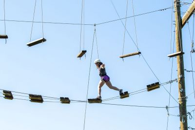 Student balancing on a high rope