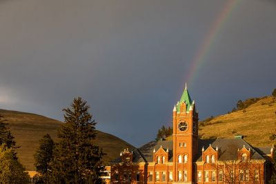 A rainbow reaches down to Main Hall.