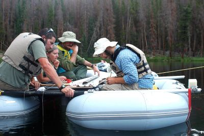 Philip Higuera, UM professor of fire ecology, and his team examine a lake-sediment core from Chickaree Lake in Colorado's Rocky Mountain National Park.