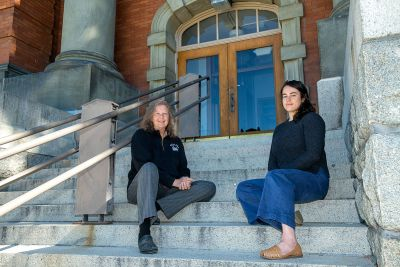 A picture of Mary-Ann Sontag Bowman and Kaya Juda-Nelson posing on the steps of Jeannette Rankin Hall.
