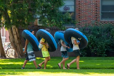 Floaters cross UM's campus bound for the Clark Fork River.