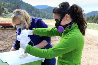 Researchers Angie Luis (right) and Amy Kuenzi prepare to collect data from a deer mouse.