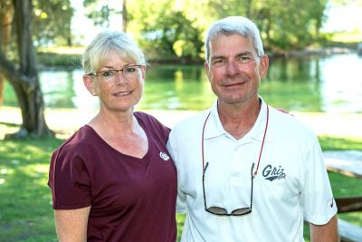 Mary Olson and her husband, Greg, in Griz Gear.