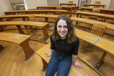UM student Betta Lyon-Delsordo sits in a classroom at the University of Montana