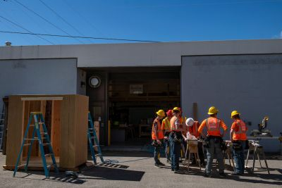 Students in surround a construction table at Missoula College
