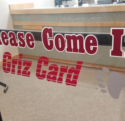 "Front door of Griz Card Center saying ""Please Come In"""