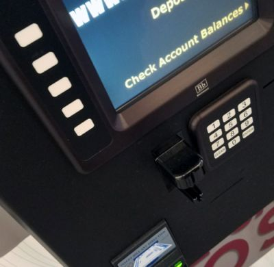 "kiosk screen saying ""deposit"" or ""check balance"" options"