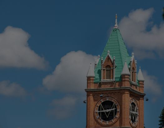 Main Hall steeple against blue sky and clouds