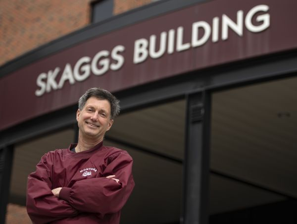 Prof. Curtis Noonan in front of Skaggs Building