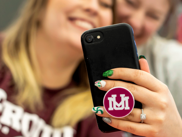 image of student on their phone