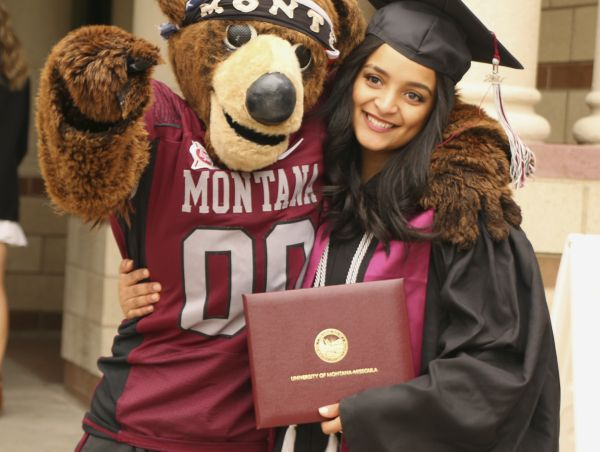 monte and student in cap and gown