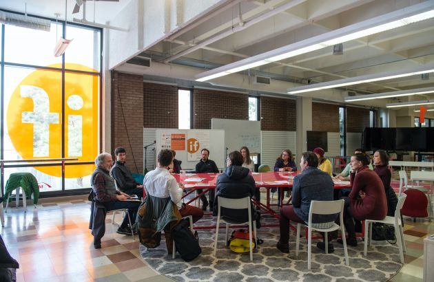 UM employees gather around a table for a professional development session