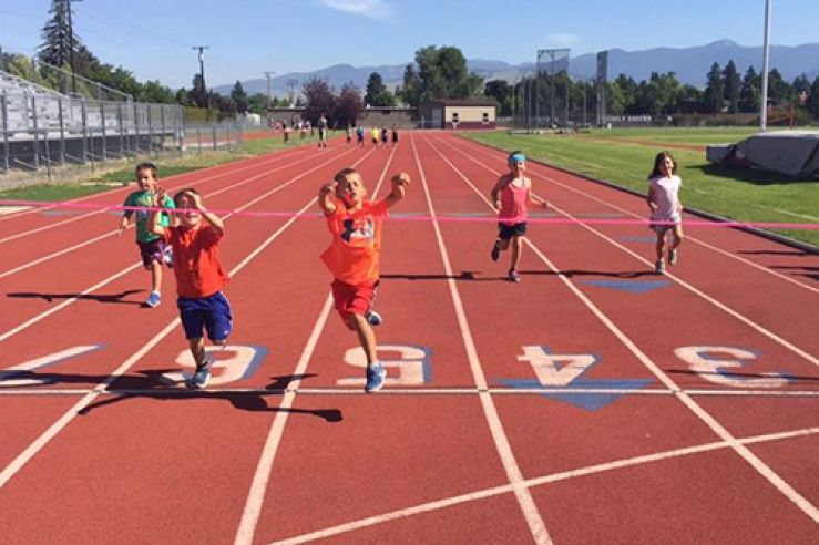Campers running on a track