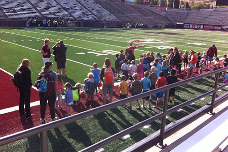 Campers on field at Washington Grizzly stadium