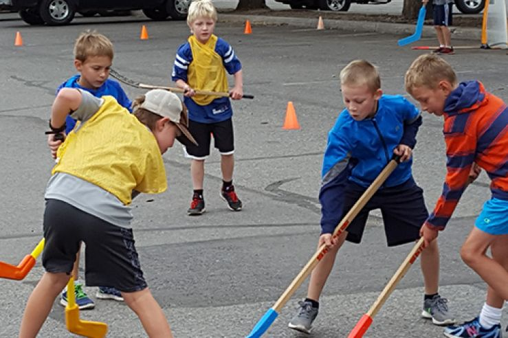 Campers playing hockey